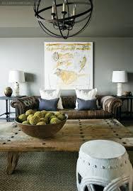 gray walls brown furniture. Black Metal Light Fixture Gray Walls White Pillows Lamps And Stool Brown Furniture N