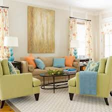 Engaging Color Scheme ~ Apple Green + Blue + Orange An open floor plan and  breezy colors give this family room an engaging look.