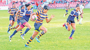 army s dulani pallikondage on her way to score a try in the cup final of the women s inter club segment i sevens rugby tournament against navy at havelock