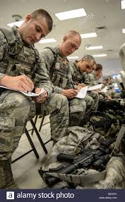 u s air force airman first class michael haney th security stock photo u s air force airman first class michael haney 354th security forces squadron entry controller fills out pre deployment paper