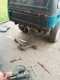 my suzuki samurai the ese poutine toyota fj cruiser forum this is the back of the truck there s nothing under the bed liner just frame rails it s not for a zook but carefully cut in half and lined up the