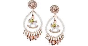 lyst betsey johnson rose goldtone beaded rocking horse chandelier earrings in white
