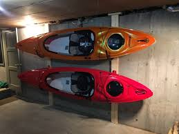 clean up your garage by storing your kayaks in a wall rack kayak garage storage diy kayak garage storage