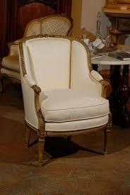 a french louis xvi style barrel back painted and gilt beechwood bergère chair from the 19th