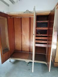 recycled old wooden triple wardrobe on legs inside 2 door full hanging rail