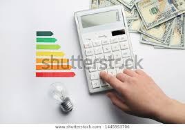 Woman Calculator Energy Efficiency Rating Chart Stock Photo