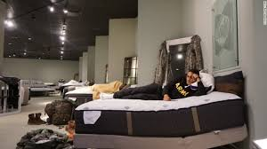 store display furniture. Aziz Shroff, 23, With The Texas National Guard, Rests On A Furniture Store Display