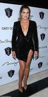 Khloe Kardashian stuns in plunging sequinned LBD on girls night.