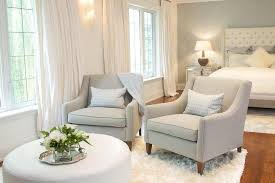 Bedroom Sitting Area with Gray Chairs and White Ottoman ...
