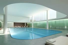 Gorgeous Pool Designs Feature Indoor Stylish Swimming Pool and Brown  Stained Wooden Couch with White Fabric Mattress
