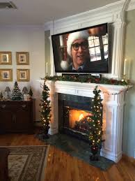 black fireplace plus white mantel bined with lamps and tree