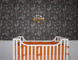 gray alphanumeric wallpaper and orange crib bedding project nursery