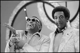 ray charles videos at abc news video archive at abcnews com ray charles laughs while holding a gun as host bill cosby looks on in a still from the new bill cosby show sept 6 1972