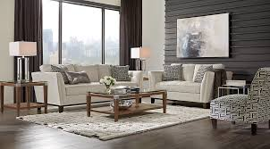 Black and white chairs living room Room Decor Cindy Crawford Living Room Set Beige Couch Set With Black And White Accent Pillows On Black And White Rug With Rooms To Go Beige Black White Living Room Furniture Decorating Ideas