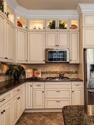 photo cream cabinets with dark granite countertops