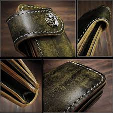 dyed leather by leather craftsmen by hand hours of carving by talented professional artisans went into the creation of this remarkable wallet