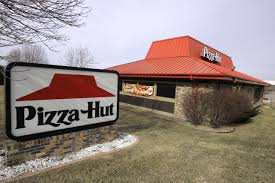 pizza hut building. Wonderful Hut Pizza Hut Is Ditching The Iconic Red Roof For A More Modern Look  Business  Dallas News Intended Building
