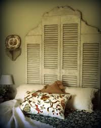 Love love love this shutter headboard.tall double shutter in the center  flanked by two shorter shutters trimmed with curved wood on the top.maybe  in the ...