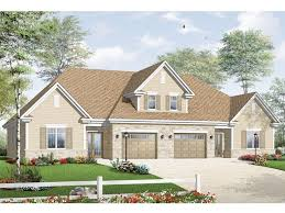 alluring duplex house plans with garage in the middle floor plan