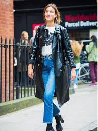 alexa chung wearing black vinyl trench coat at london fashion week