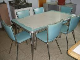 we found this great 1950 s formica and chrome set at an estate i really liked the atomic look of the table top the original vinyl on the