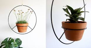Inspired by vintage hanging plant holders, Angie Johnson has created this  modern black hanging planters