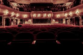red theater chairs. Person Architecture Auditorium Audience Room Theatre Chairs Indoors Lights Stage Cinema Theater Seats Ballroom Entertainment Screenshot Red