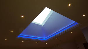 skylight lighting. this lighting changes colours by remote control seen here with blue light creates a very dramatic effect in the customers foyer area skylight i