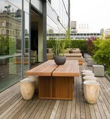 modern patio set outdoor decor inspiration wooden: long wooden table and stone chairs sets with beautiful garden in outdoor patio furniture designs