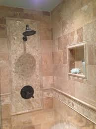 pictures of bathroom walls with tile walls which incorporate a tile design set in in the main shower wall