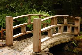 there is something so elegant about the smooth arches of a wooden bridge this one