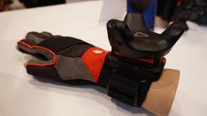 htc vive tracker. the htc vive tracker attached to vr gloves. htc i