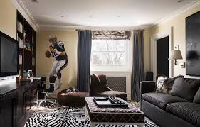 Example of a trendy enclosed carpeted family room design in Philadelphia  with beige walls and a