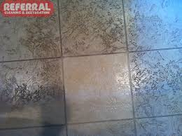 tile cleaning contrast on a textured tile with dirt embeded in s and pores