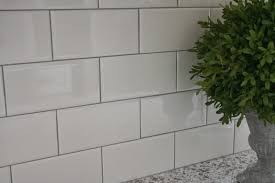 kitchens with white subway tile and grey grout light bathroom beveled