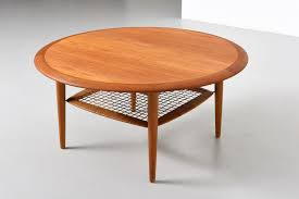round coffee table in teak with rattan shelf modestfurniture com m