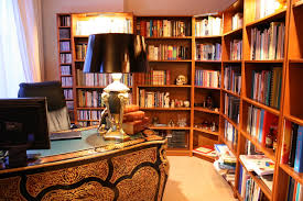 library home office renovation. home library decor theme features l shape open bookshelf and wooden varnishing shelf table decoration office renovation