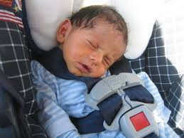 the baby s chin is on his chest there is an aftermarket infant head support used the white behind the child s head