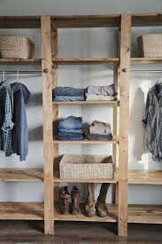 industrial style wood slat closet system with galvanized pipes build industrial furniture