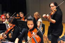 Ivonne Hernandez, right, with the Boston String Quartet,... 435154 -  Connecticut Post