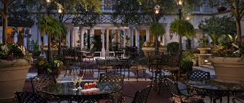 beautiful ritz lighting style. relax day or night in lush french quarter style courtyard of the ritz carlton beautiful lighting