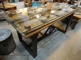 antique door dining table with gl top and metal base denver furniture