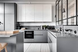 grey color kitchen cabinets simple natural wooden counter simple round black leather stool smooth white marble countertop