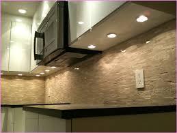 home recessed puck lights under cabinet design