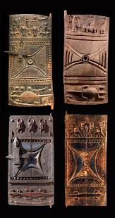 west africa carved wooden doors from the senufo people