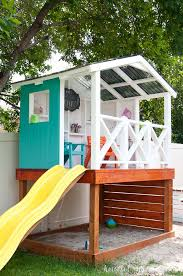 building the outdoor playhouse over a sandbox was the perfect solution for our small yard