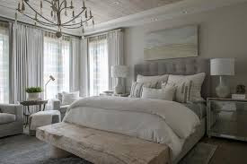gray tufted bed with mirrored