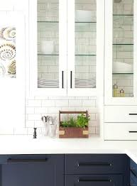 glass shelves for kitchen cabinets glass front white kitchen cabinets accented with glass shelves are fixed