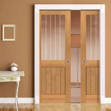 Double Pocket River Thames Oak Half Light sliding door system in three size  widths with Etched