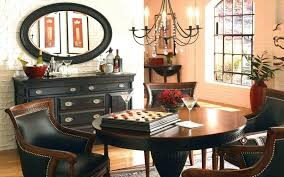 black rustic kitchen chandelier over round dining table and chairs set